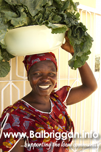 Skha Ndlovu, chair of the market garden group, taking kale to the processing centre