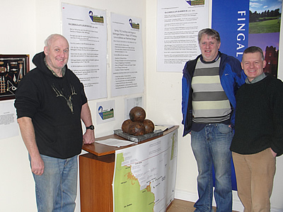 Cannon balls display in Balbriggan Tourist Office with Maritime Museum committee. members John Daly (Fisherman) Johnny Woodlock (Treasurer), Trevor Sargent (Chairperson)